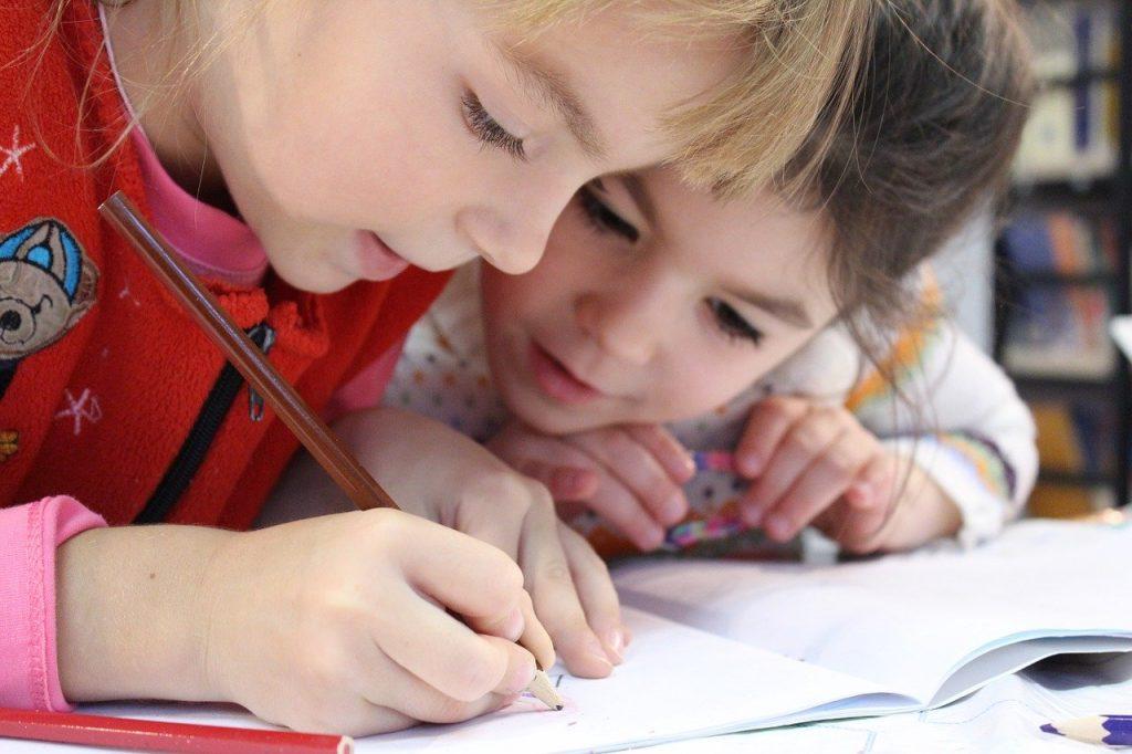 Children working together on a project. https://www.brandcontentstudios.com